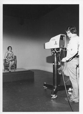 Photograph of an unidentified person being filmed
