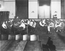 Photograph of two dressmaking classes