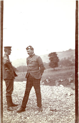 Photograph of T.H. Raddall, Sr., with another uniformed officer on or near Reach Field in Hythe, ...