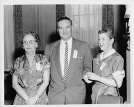Photograph of an unidentified female, C.D. Bishop and M.B. MacKay at annual meeting