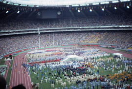 Photograph of the opening day ceremony and the torchbearers
