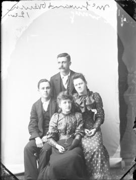 Photograph of four unidentified people