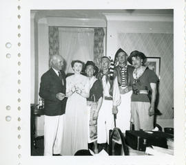 Photograph of Thomas Head Raddall with the singing quartet The Privateers and an unidentified woman