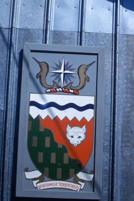 Photograph of the Northwest Territories crest on the side of a building in Frobisher Bay