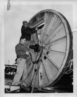 Photograph of cable foreman J.A. Caldwell and John Motton checking gas pressure