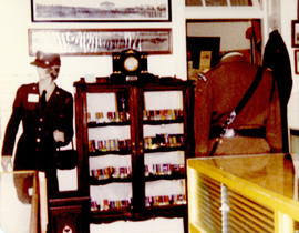 Photograph of a cabinet display of artifacts from the Royal Winnipeg Rifles Regiment