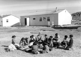 Photograph of a class being held outdoors in Cape Dorset, Northwest Territories