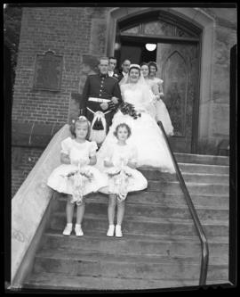 Photograph of Mr. & Mrs. Leil and the flower girls standing on the steps of the Church
