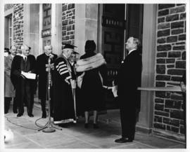 Photograph of Chancellor C.D. Howe and Lady Dunn entering the Sir James Dunn building