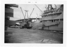 Photograph of an unidentified Pulp Ship loading lumber at the East River Dock, Sheet Harbour