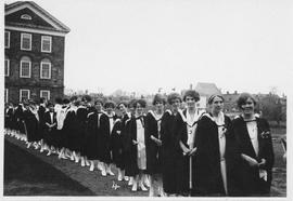 Photograph of a procession of graduates