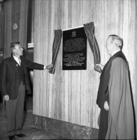 Photograph of Robert Stanfield and an unidentified person unveiling a plaque
