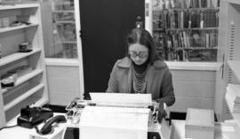 Photograph of Paddy Burt working at the Killam Library, Dalhousie University