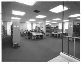 Photograph of work tables and book shelves in the Sir James Dunn Law Library
