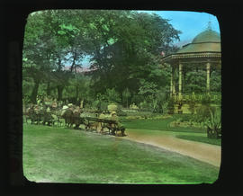 Photograph of people sitting on benches near the bandstand in the Halifax Public Gardens