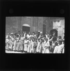 Photograph of children inside an unidentified building