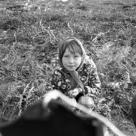 Photograph of Jessie sitting on the ground in Fort Chimo, Quebec