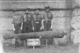 Photograph of four boy scouts with a gun from Louisbourg