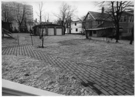 Photograph of a lawn between department houses