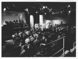 Photograph of a CBC performance at the F. H. Sexton Memorial Gymnasium