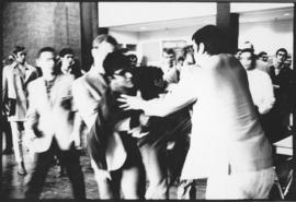 Photograph of the newly formed Campus Police forcibly removing a member of a Maoist group trying ...