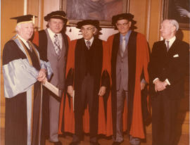 Photograph of Henry Hicks and four unidentified people at a special convocation