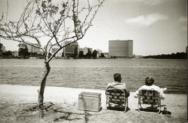 Photograph of two people sitting in lawn chairs looking at San Francisco Bay