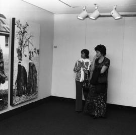 Photograph of unidentified people looking at a piece at the Dalhousie Art Gallery