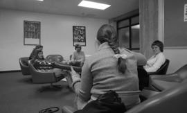 Photograph of students sitting in a lounge in the Dalhousie Arts Centre