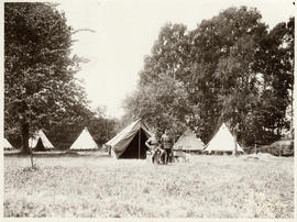 Photograph of Dr. John Stewart and officer in front of officer tents