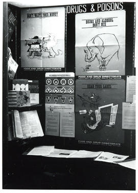 Photograph of display case exhibit Drugs & Poisons