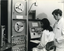 Photograph of Dr. I. Valimaki and a computer operator in the Medical Computer Centre