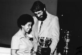 Photograph of Julie West and Dr. Michael J. Ellis : Class of '55 Trophy presentation