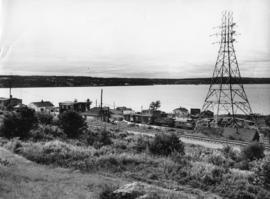 Photograph of a train running through Africville
