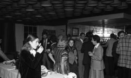 Photograph of people mingling at an alumni scholarship presentation