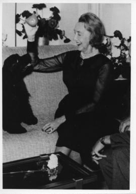 Photograph of Dorothy Johnston Killam playing with a dog
