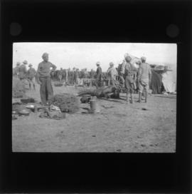 Photograph of unidentified soldiers and people