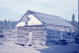 Photograph of a log cabin used by the Oblate mission in Davis Inlet, Newfoundland and Labrador