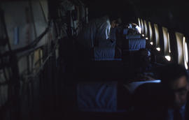 Photograph of passengers and cargo on an airplane