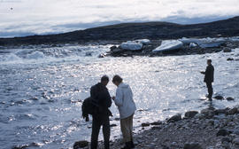 Photograph of Barbara Hinds and Frank Deloute standing by the water at Frobisher Bay, Northwest T...