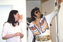 Photograph of Librarian Shelley McKibbon and Elvis impersonator striking a pose