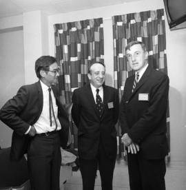 Photograph of three people at an event for the Dalhousie medical centennial