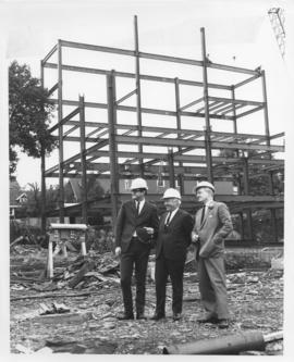 Photograph of Dennis Ashworth, Henry Hicks, and Donald McInnes at the Student Union Building cons...