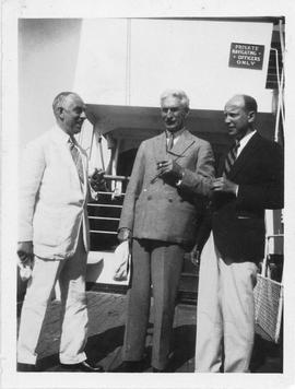 Photograph of Arthur Stanley MacKenzie and two unidentified people on a cruise ship