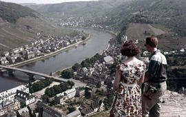 Photograph of two unidentified people looking over Cochem