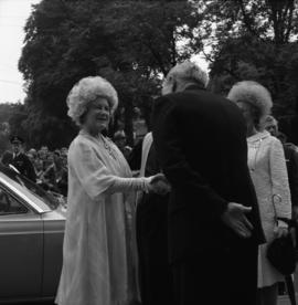 Photograph of an unidentified person greeting the Queen Mother