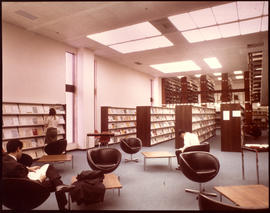 Photograph of the first floor stacks and reading room in the W.K. Kellogg Health Sciences Library
