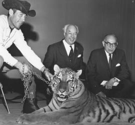 Photograph of Henry Hicks and G. I. Smith with a live tiger at the opening of the Student Union B...