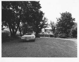 Photograph of a car parked near the Dalplex construction site