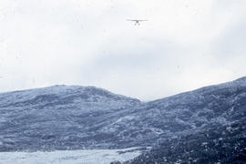 Photograph of an RCMP airplane arriving in Cape Dorset, Northwest Territories